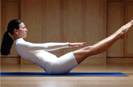 woman in white doing pilates